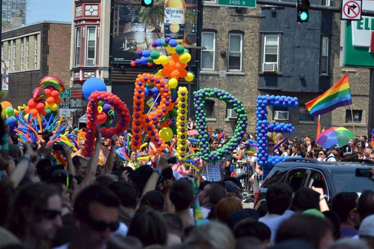 "Rainbow colored balloons spelling ""pride"" during parade in Chicago"