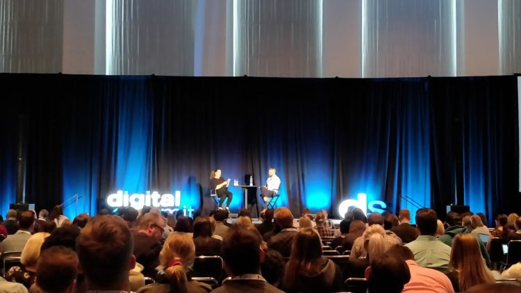 People discussing topics on stage at the Chicago Digital Media Summit 2018