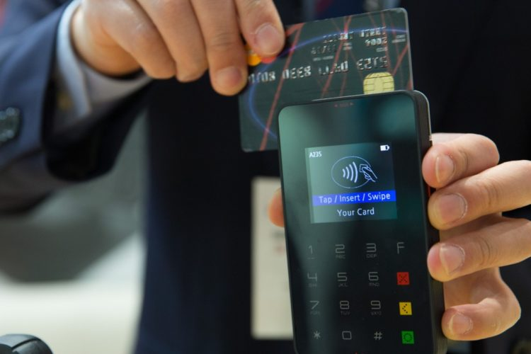 Credit card being swiped on a mobile card reader