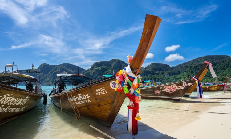 Boat tied to shore in Thailand