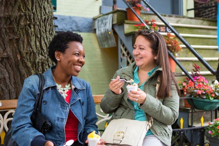 Two women enjoying an ice cream treat in Chicago