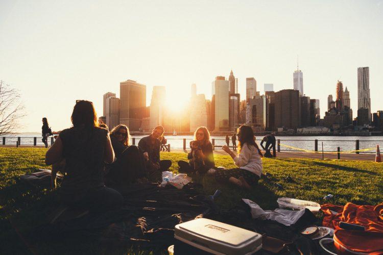 Women enjoying a picnic meetup along Lake Michigan in Chicago