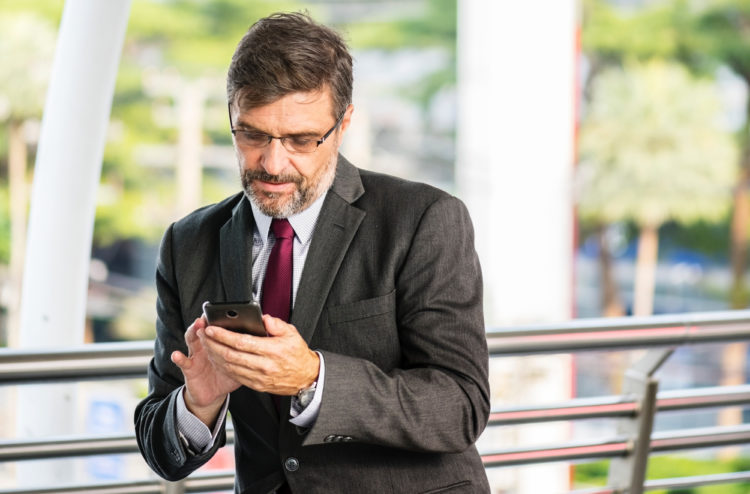 Business man checking smartphone